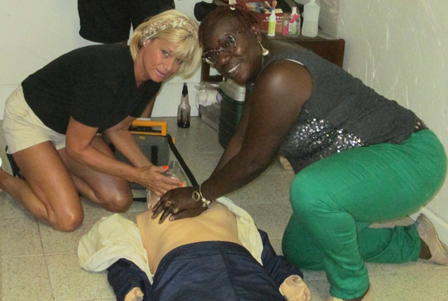 Judy Sinnamon and Stephanie Christian practice CPR at St. John Rescue.