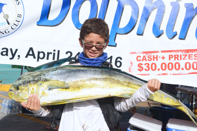 9-year-old Robbie Richards holds his winning catch at the 21st Annual Dolphin Derby. (Photo by Dean Barnes)