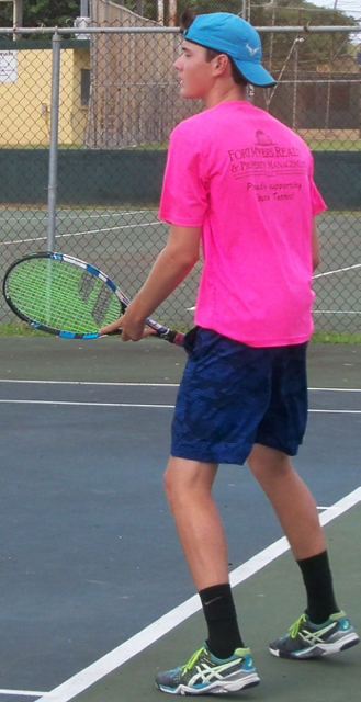 Alec Kuipers returns a serve.