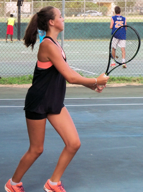 Ava Neuburgher-Highby follows through on a backhand.