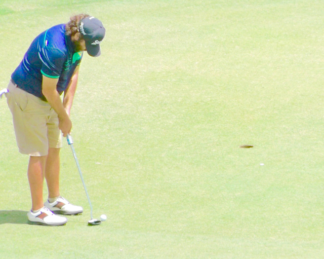 Kevin Ferris lines up a putt on the final hole. If he made, he'd have won the tournament. His missed, and took second.
