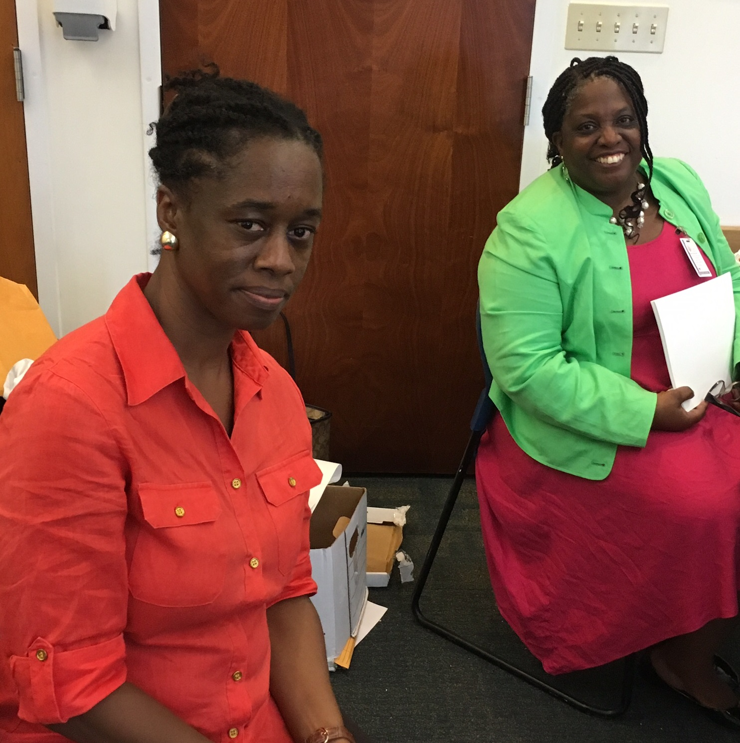 Denise Gomes, program manager, and Valrica Bryson, director of Cultural Education, share a moment at the Culture Bearers Conference on St. Thomas on Sept. 2.