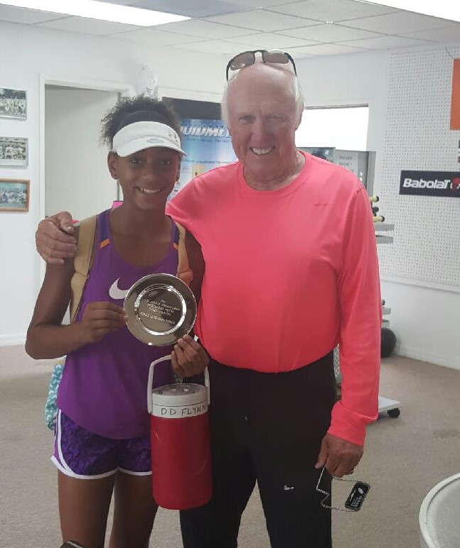 D'avian Lewis-Flynn receives her third place award from Don Dewilde, tournament director, on Sept. 19.
