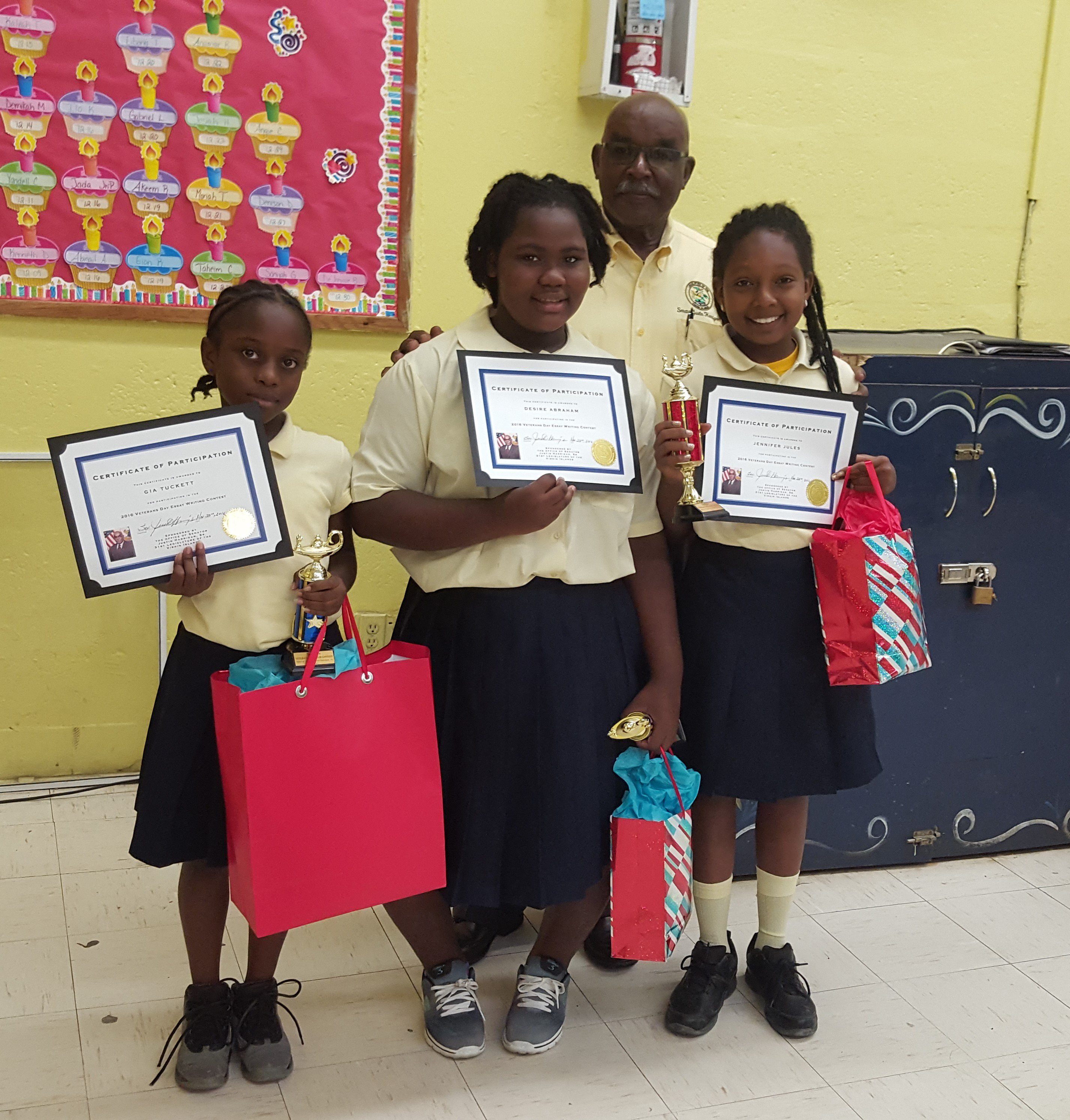 The senator with the 1st, 2nd and 3rd place winners of Sprauve School