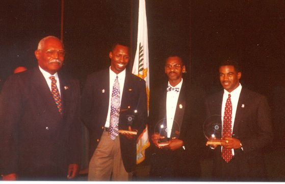 R to L Derry Pemberton, Neville Hodge, Keith Smith. Edgar Isles, then president of the Virgin Islands Olympic Committee, presents the award at the VIOC Banquet at Frenchmans Reef (Photo by Wallace Williams, VITFF)
