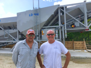Adam Cook, left, and Tom Buttermore stand with their high-efficiency LO-PRO 327.