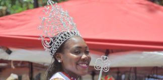 St. John Festival Queen Jeminie Niles rides in Tuesday's parade.