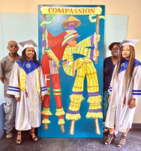 From left, Dwaydale Dariah, Zaquira Carri, Bianca Alexis, Danica David at the St. Croix Educational Complex High School. The school's National Art Honor Society students designed the second Barra Virtue Mocko Jumbie mural. Alexis and Carri were among those who completed the project. (Photo by Talisa Alexis)