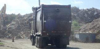 Truck hauls trash at St. Croix's Anguilla landfill recently (Susan Ellis photo)