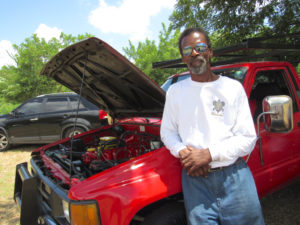 Bobby Flemming leans against his 1986 Chevy Truck at the Love City Car Show.