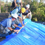 Contractors install roofting material for Project Blue Roof in this Florida photo from the Army Corps of Engineers.