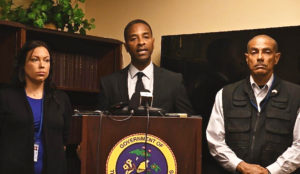 From left, Dr. Jacqueline Pender, Attorney General Claude Walker and acting Forensic Division Head Robert Soto.