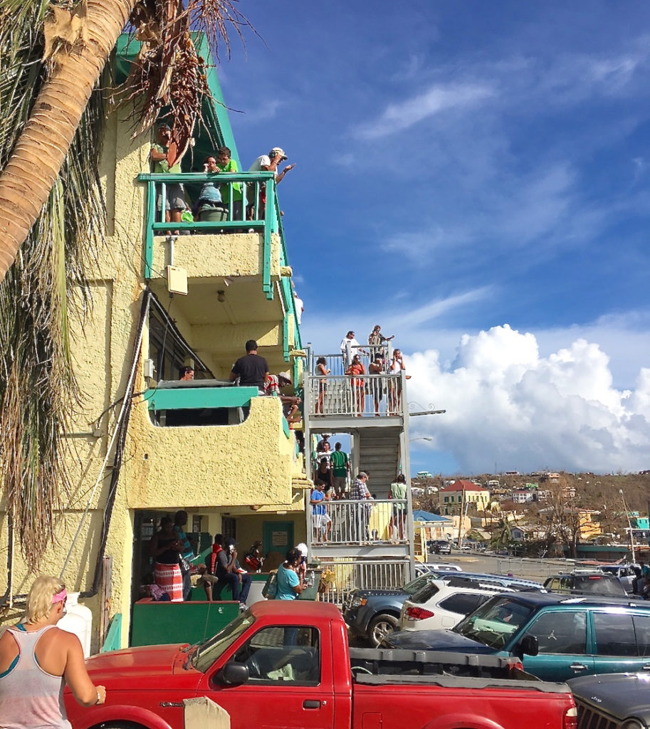 Days after Irma, St. John residents cluster around the Boulon Center on Sept. 10. The center was only spot with cell service in Cruz Bay.