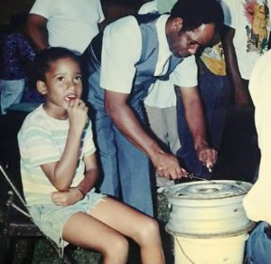 Harold Johnson Sr. plays percussion on an improvised instrument, an auto wheel. (Johnson family photo)