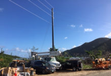 Workmen raise another composite pole on St. John. The new poles are replacing wooden poles that essentially haven't changed significantly in more than 100 years.