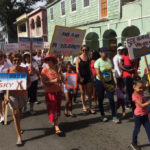 Women and men of all ages join to march through the streets of Christiansted for the Women's March.