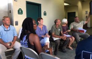 Board members share a joke as the meeting gets underway.
