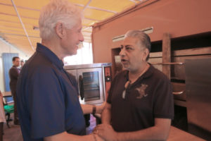 In February 2018, Former President Bill Clinton meets with community members, including India Association president Pash Daswani, to talk about hurricane recovery issues.