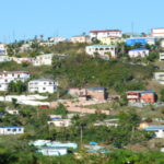Blue tarps covering damaged roofs dot the landscape of Estate Tutu on St. Thomas in March 2018. (Bill Kossler photo)