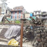 Piles of ancient timber, galvanized and hand carved artifacts await reuse at sacred site in Kathmandu.