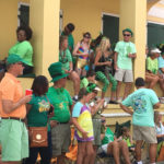 A festive crowd gathers to view the parade from the front steps of Government House in St. Croix. (Ivy Hunter photo)