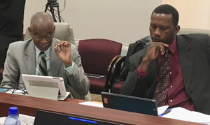 Port Authority board members Jose Penn and Marvin Forbes discuss a compliance audit at Wednesday's meeting.