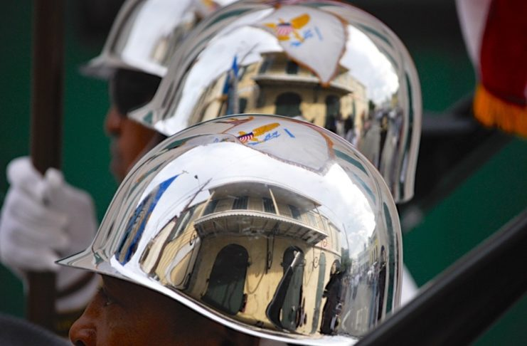 Reflections of the V.I. flag in the helmets