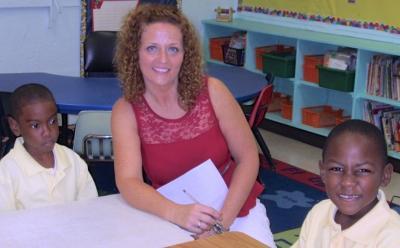 Zhyiare Penn, 6, teacher Tracey Maish and Ne'Kyle Alfredo, 6
