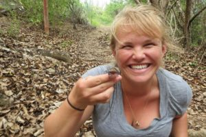 Nicole Angeli shows off a St. Croix ground lizard on Buck Island. (photo courtesy of Nicole Angeli)