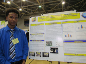 UVI undergrad Hairol Breton with his presentation studied the phenolic content of Old Man's Beard.