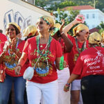 """V.I. Carnival Village honoree Judy Watson, center, leads her Gypsies Troupe from Emancipation Garden to the official opening of """"Judy's Gypsyville."""""""