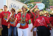 "V.I. Carnival Village honoree Judy Watson, center, leads her Gypsies Troupe from Emancipation Garden to the official opening of ""Judy's Gypsyville."""