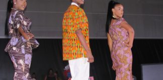 Three models displayed African inspired designs at a fashion show at UVI.