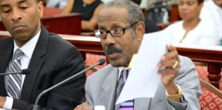 Dr. Alfred Heath, right, testifies before the Legislature in 2016, flanked by Attorney General Claude Walker. (File photo)