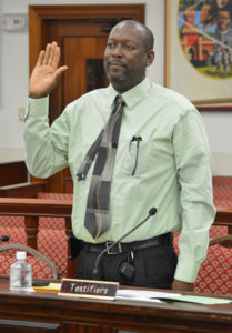 V.I. Carnival Committee Executive Director Halvor Hart stands to testify under oath. (V.I. Legislature photo)