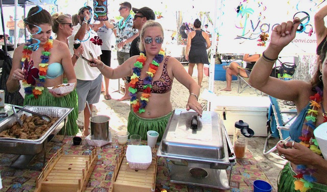 The Hawaiian volcano was the theme at the Lucky Chops booth, where the hot lava sauce was flowing. (Gerard Sperry photo)