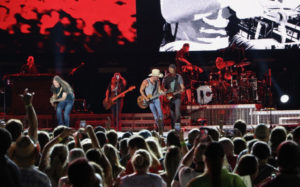 Kenny Chesney, center in white cowboy hat, and his band perform for the huge crowd in Philadelphia. (Photo by William Stelzer)