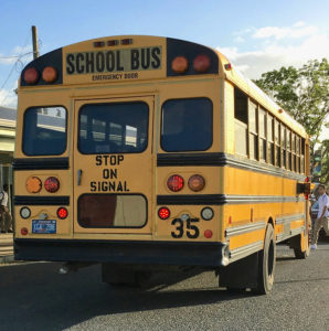 A school bus picks up students. (File photo)