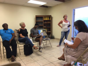 Site manager Nancy Clendenin, standing, updates tenants at the meeting Tuesday. Seated, from left, are Christine Charles Laurent, Mary Castle Bartolucci, Kenisha Small, and Keryn Bryan.