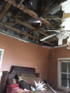 Neighbors used galvanized roofing found lying on the ground after Hurricane Irma to temporarily repair the roof for the tenant of this Bellevue apartment. That temporary patch is still all that's keeping the weather out.