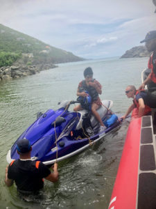 The boat crew of a Coast Guard SPC-LE stationed on St. Thomas take a pair of stranded boaters aboard off Hans Lollik Island.