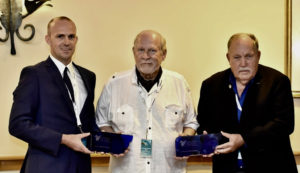 Billy Bohlke, left, and his father, Bill Bohlke Sr., accept Sapphire Pegasus awards from Bud Slabbaert of St. Martin, founder the Caribbean Aviation Meetup. (Photo by Kemuel Stubbs)