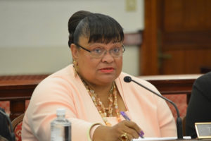 Education Commissioner Sharon McCollum tries to respond to questions from the Senate Finance Committee.