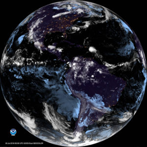 Satellite photo shows the remnant of Beryl, the last white mass of clouds slightly up and right of center, passing into the Caribbean early Monday morning.