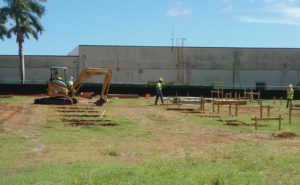Workmen mark off space for installation of soon-to-arrive modular classrooms Thursday on campus at Lockhart Elementary School.