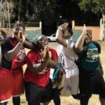 Men's Summer League players show team spirit after Friday's games.