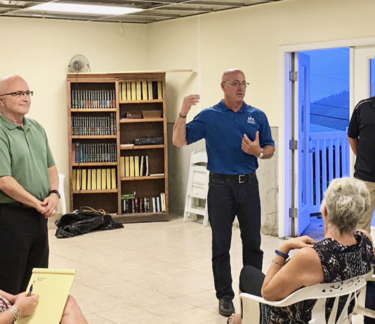 From left: Rick White of AIG, Philip Roy of DPA, and Dave Marshall of Shear Construction field questions at a tenants association meeting at Bellevue Village.