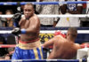 Clayton Laurent, Jr. delivers another series of combo shots to Sherman Artis in Saturday's gith in Brooklyn, New York.