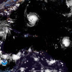 NOAA satellite photo taken at 8:30 p.m. Wednesday shows Tropical Storm Isaac, right, on the doorstep of the Antilles, while Hurricane Florence, a Category 4 storm, takes aim at the U.S. east coast.