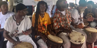 """The Drummers of the Macislyn Bamboula Dance Company and Odomankoma Asawfo. From Left: Michael George, Shadion Brown, Keith """"Keibo"""" Brown, Earl Demmin, and Delroy """"Ital"""" Anthony."""